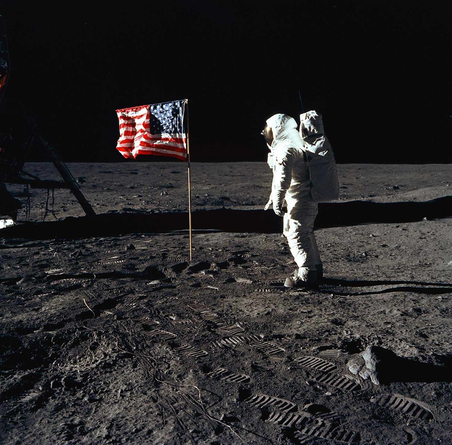 Man on the moon with an American Flag