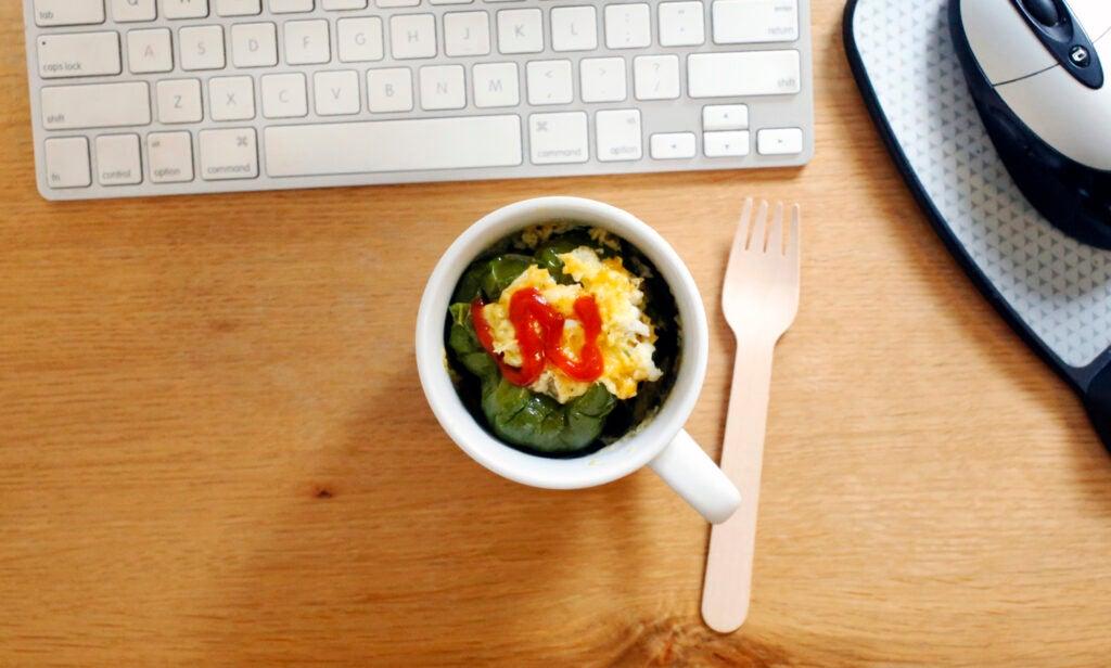 microwaved stuffed pepper on a desk