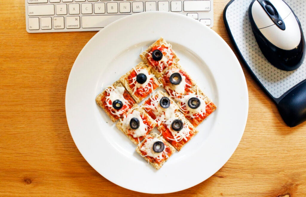 Triscuit pizza bites on a desk