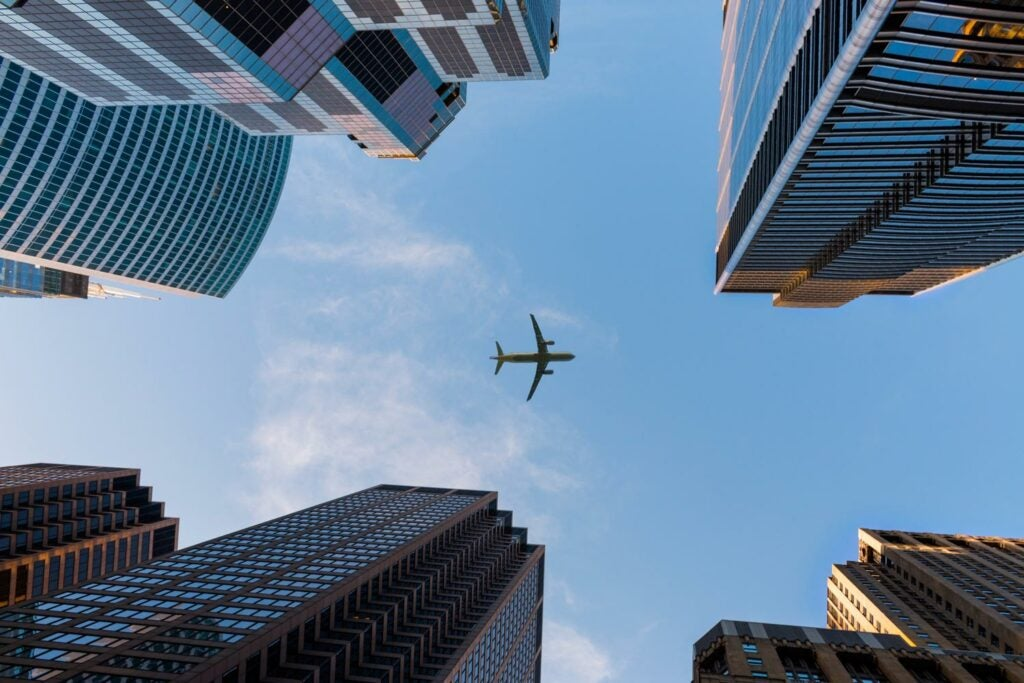 An airplane flying above Chicago