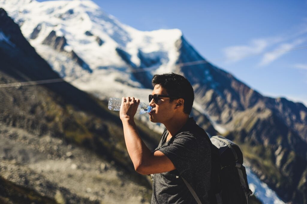 Man drinking water on a mountain
