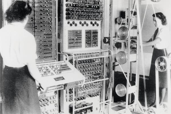 woman in front of an old computer