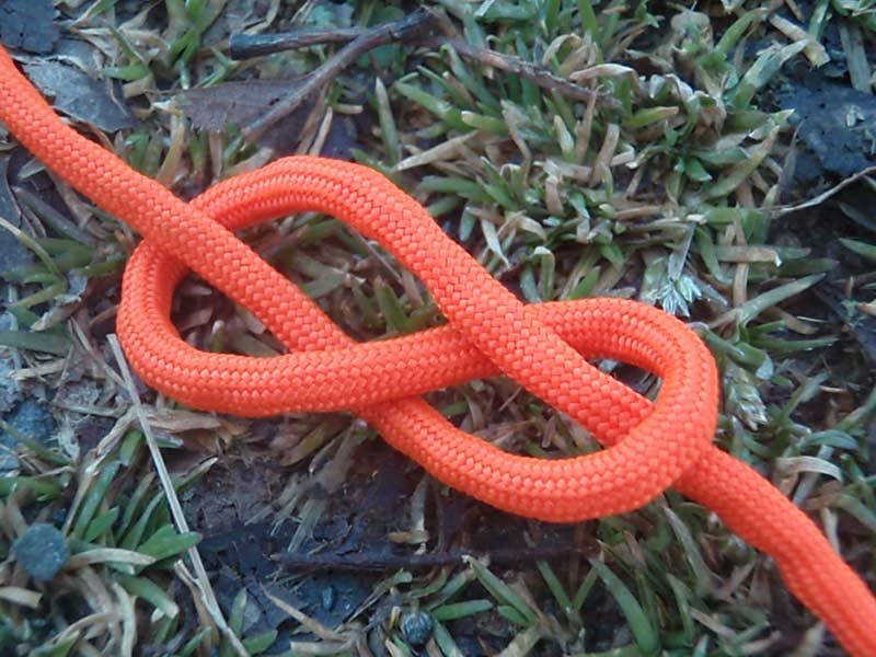 a figure 8 knot with orange paracord