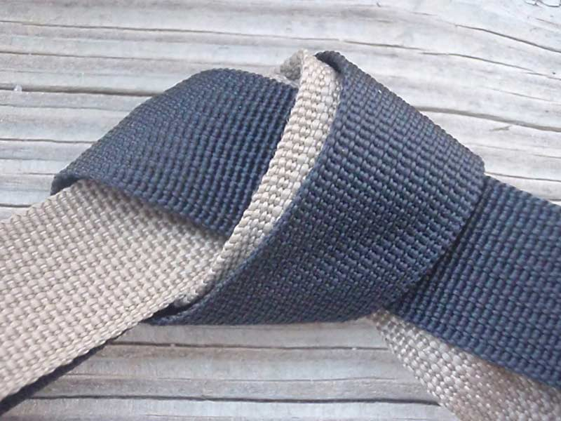 belt straps tied in a knot