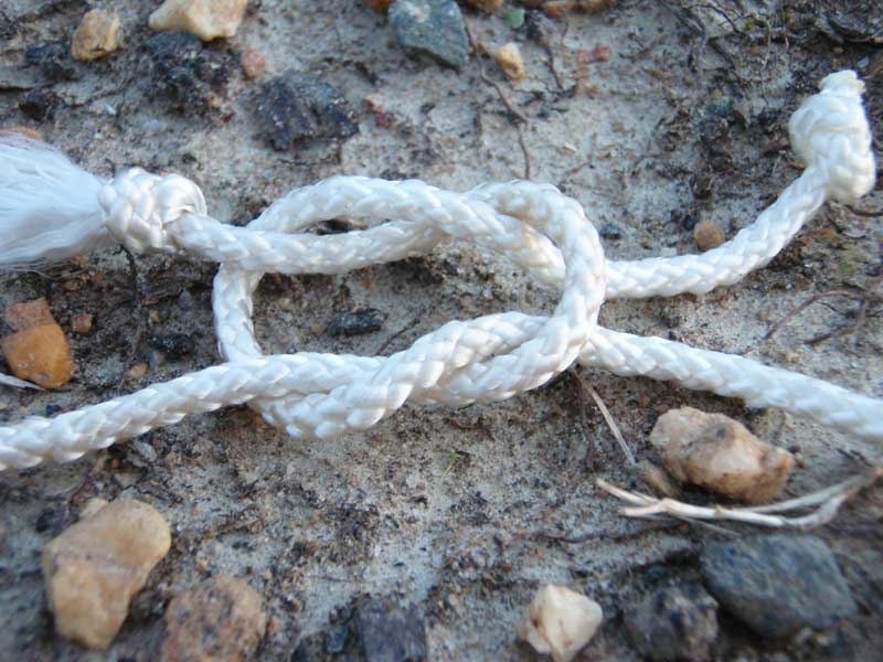 a square not with white paracord