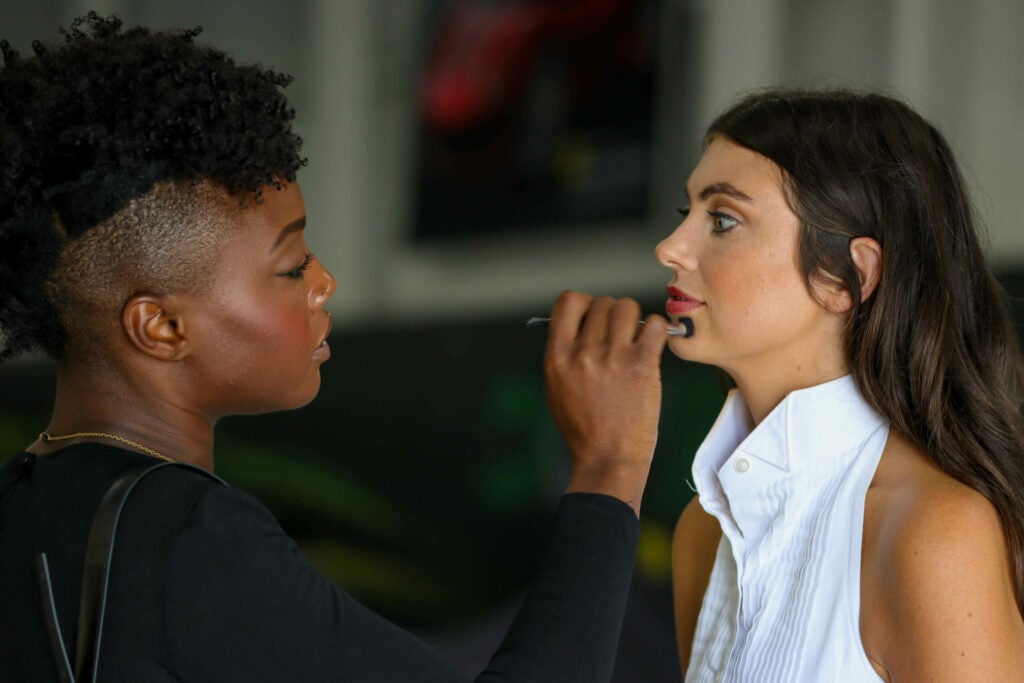 makeup being applied to womans face