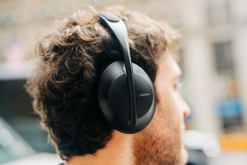 Bose 700 headphones worn by a man