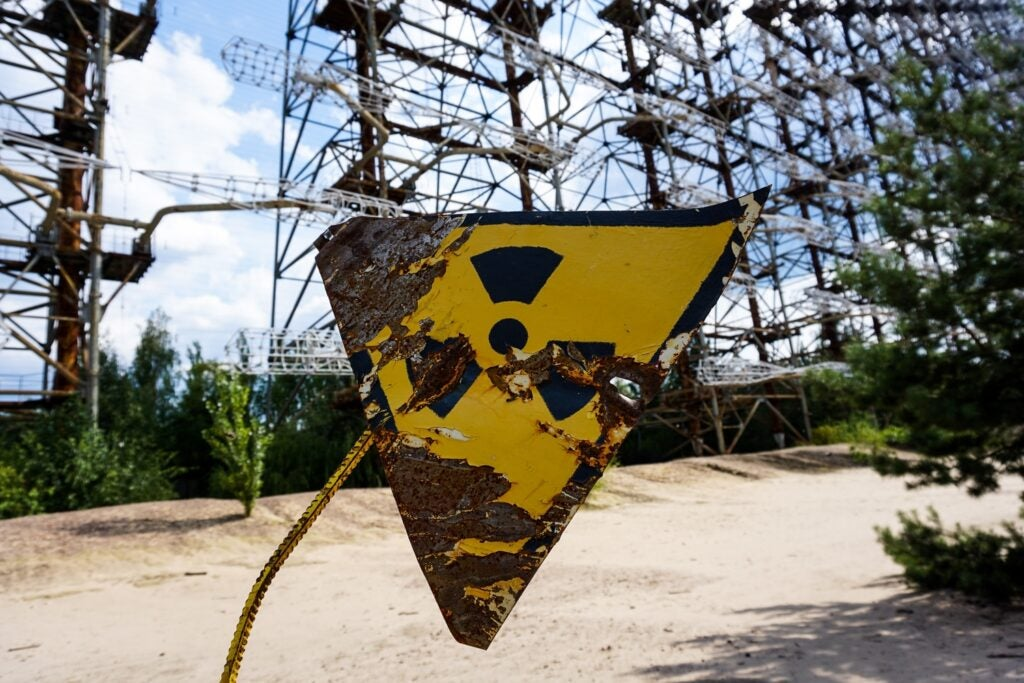 a damaged nuclear radiation hazard warning sign in Pripyat, Ukraine