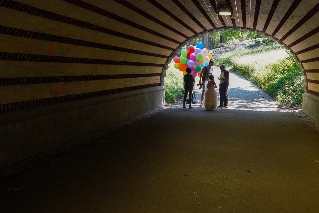 family with balloons at the end of a tunnel