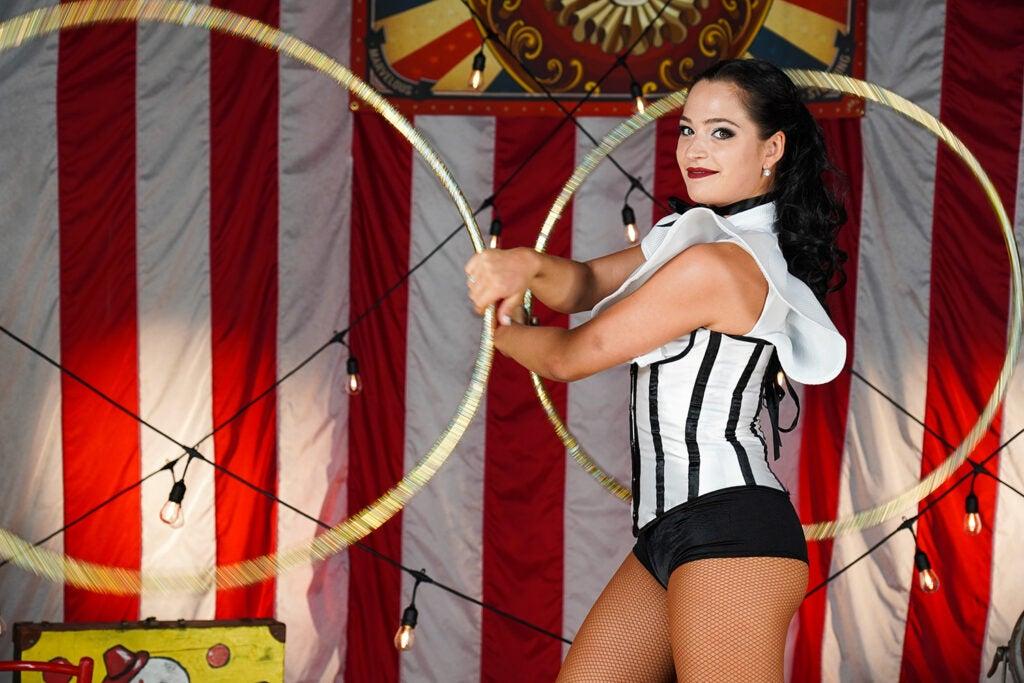 circus performer twirling hula hoops