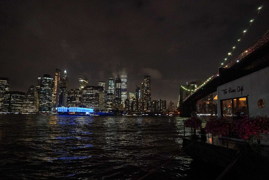 city lights over the water at night