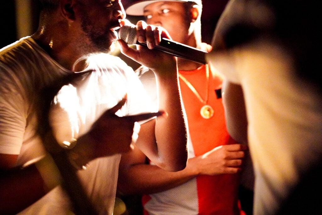 singers performing in group