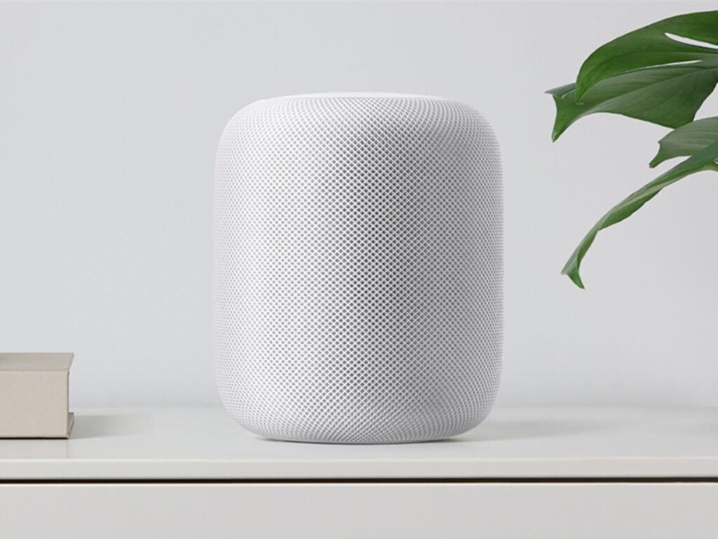 apple homepod on a white desk