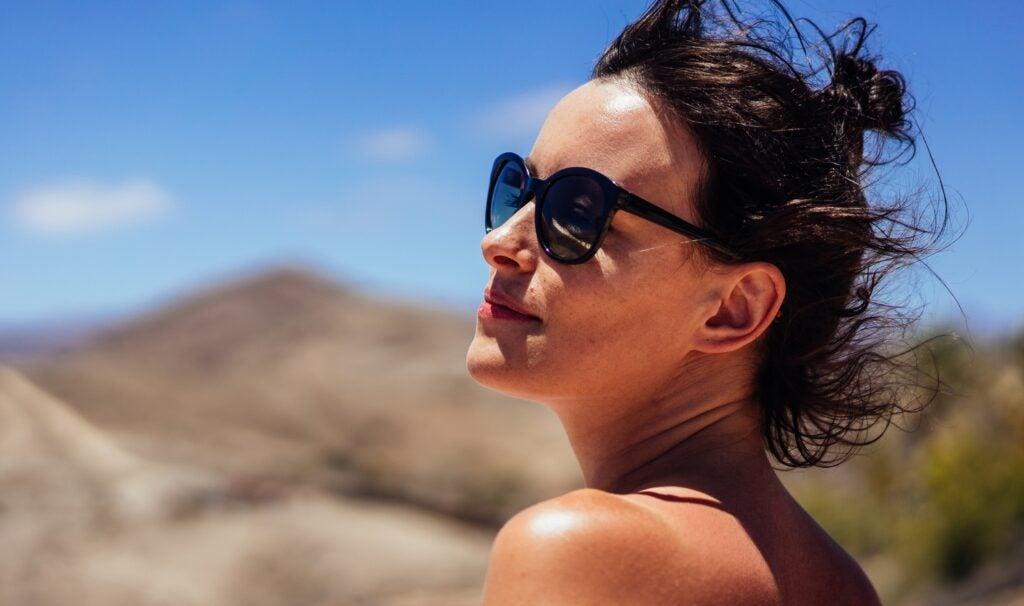 woman in sunglasses sunbathing