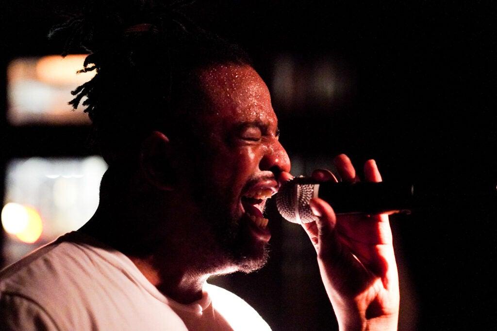 singer sweating hard while performing