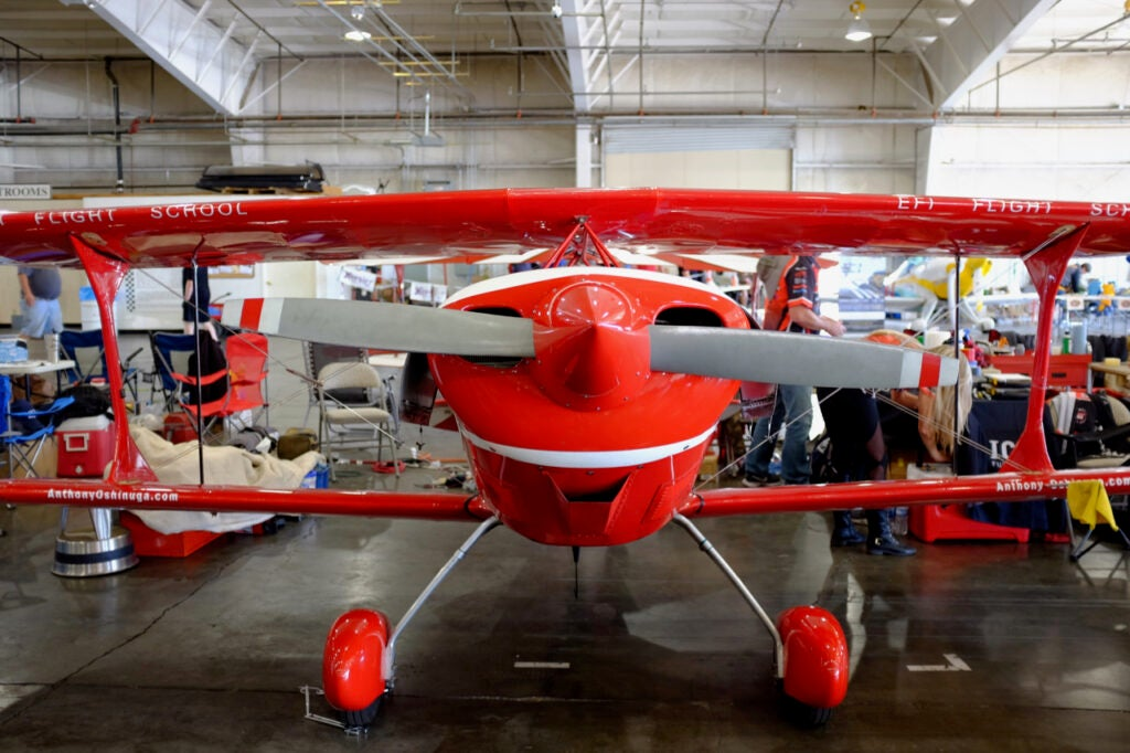 Pitts S-1S aerobatic red biplane from the front