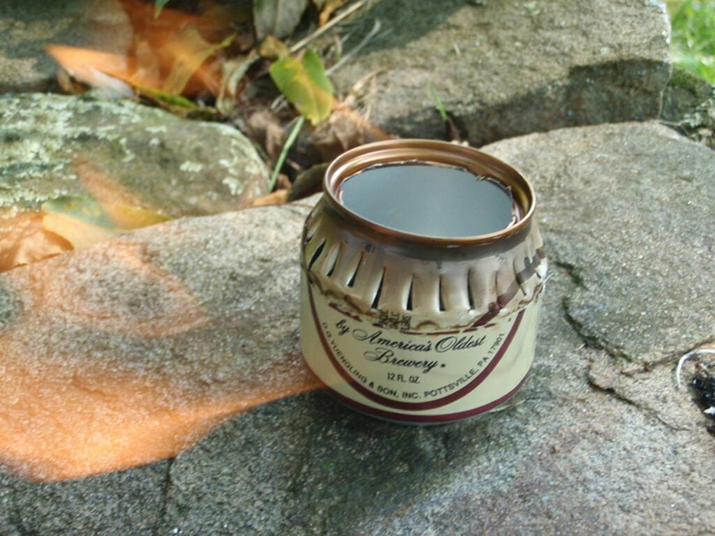 A lighted beer can emergency stove.