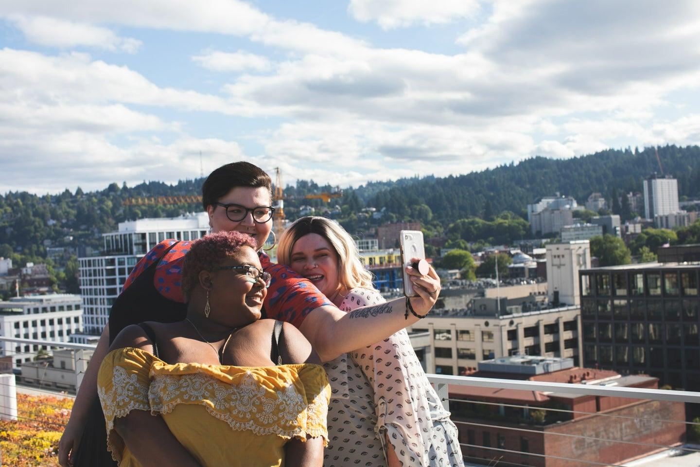 three plus-size women take a selfie