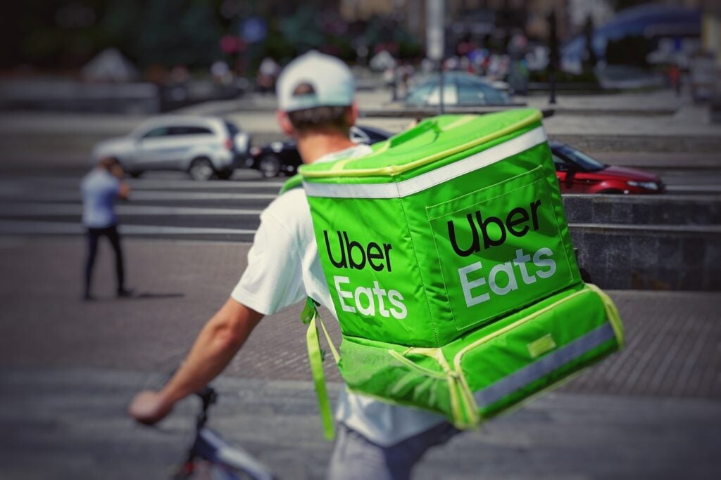 an Uber Eats delivery person on a bike