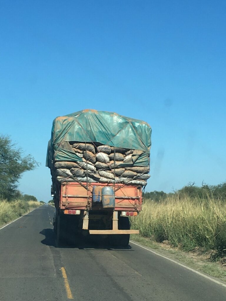 Bags of charcoal stacked on a truck
