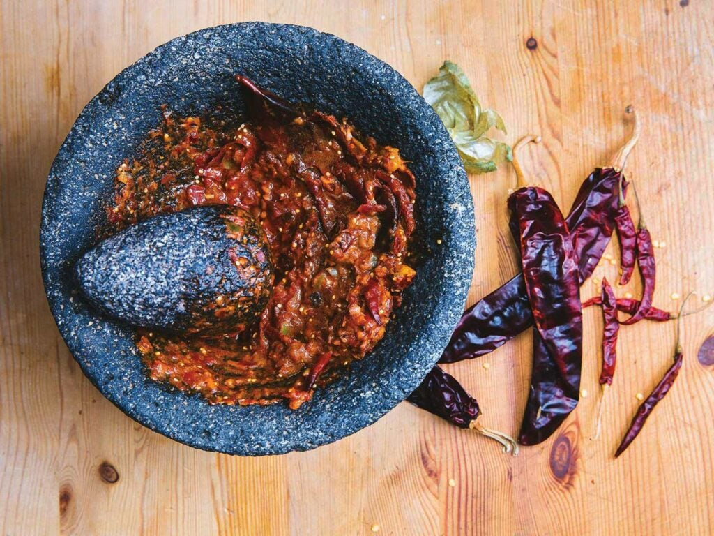 homemade salsa in a mortar and pestle