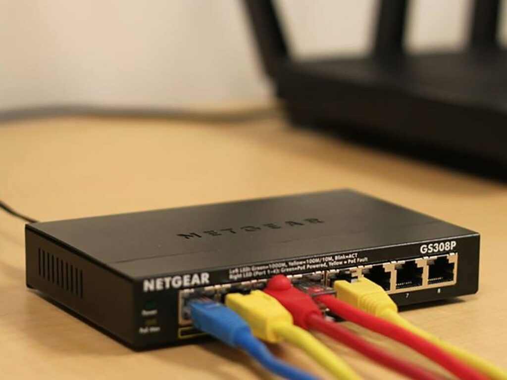 a Netgear router with blue, yellow, and red wires