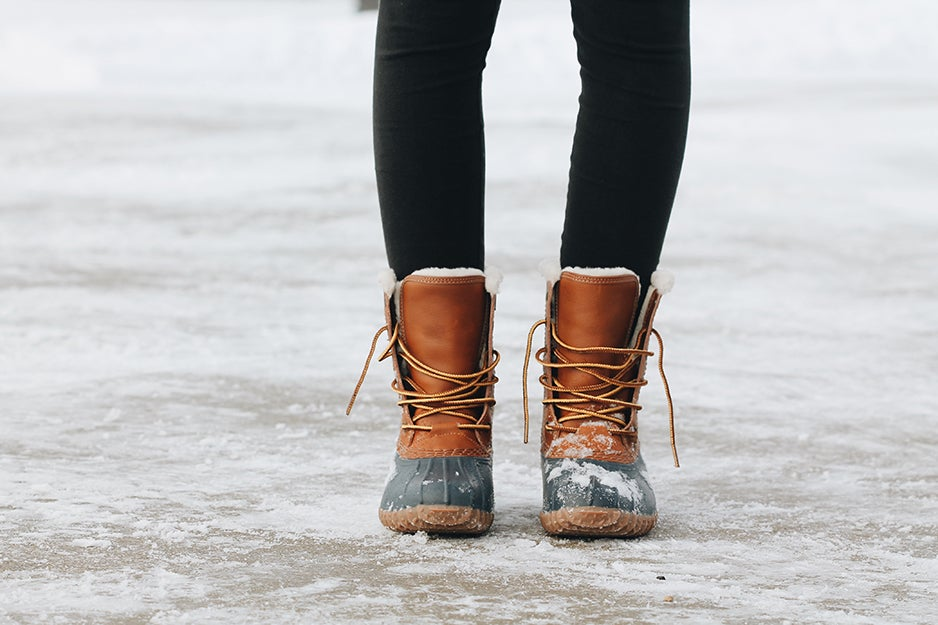 woman in boots on snow