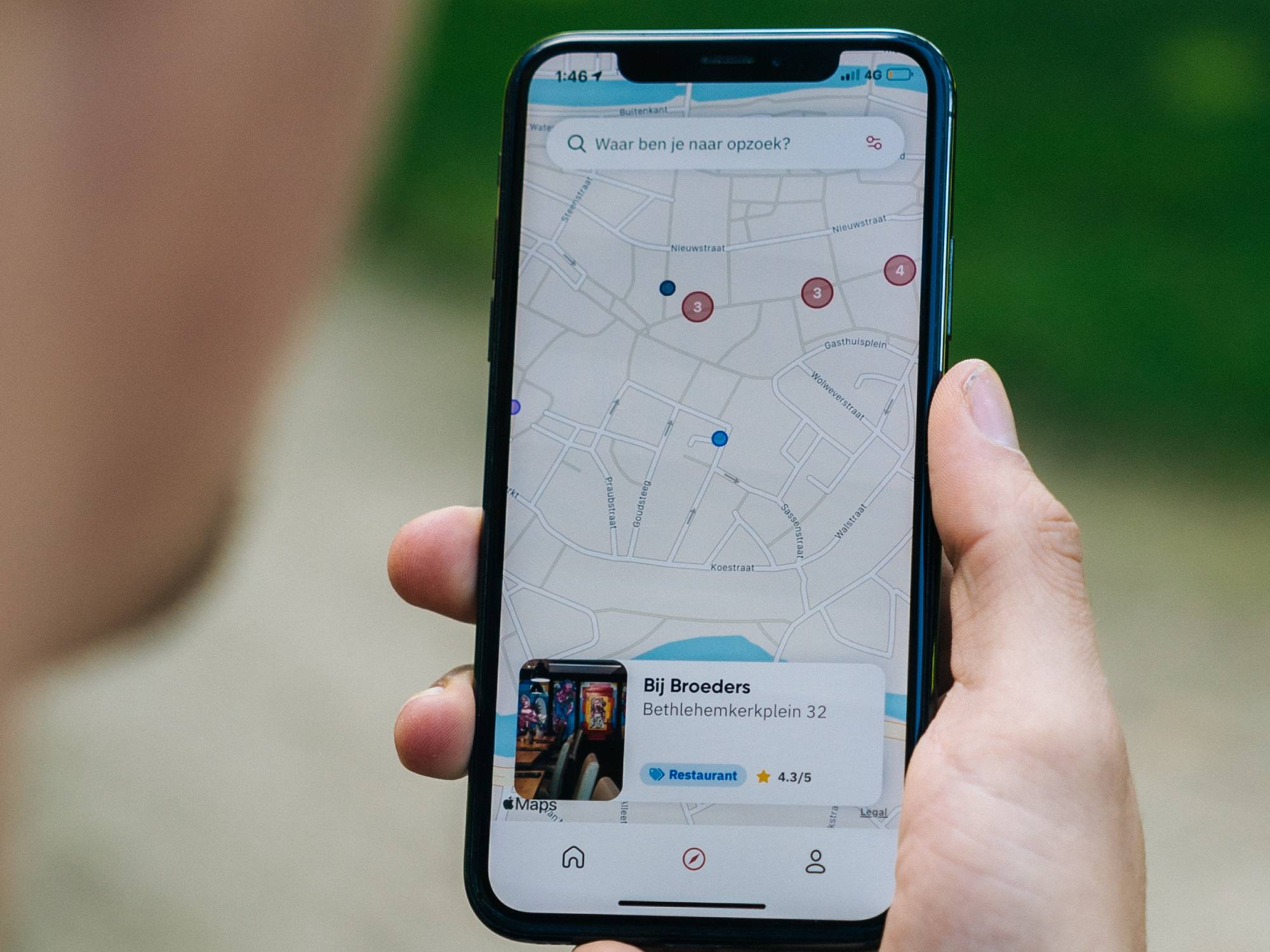 hand holding phone screen showing Apple Maps
