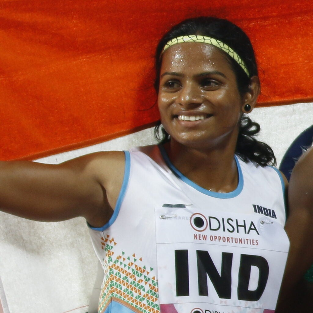 dutee chand celebrating a bronze medal in the 4x100 meter relay