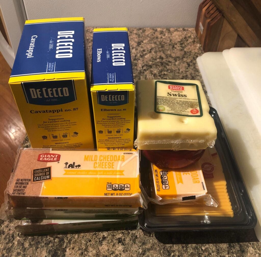 macaroni and cheese ingredients on a counter