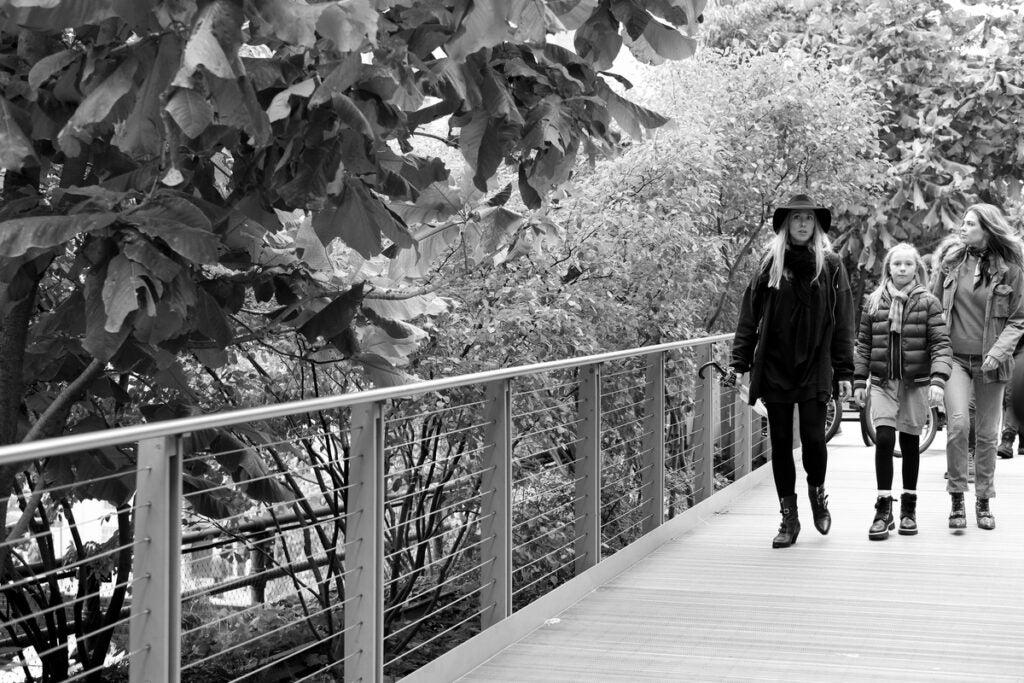 3 girls walking on bridge