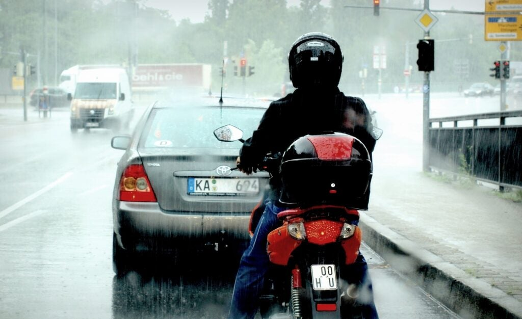 motorcycle rearending a car in the rain