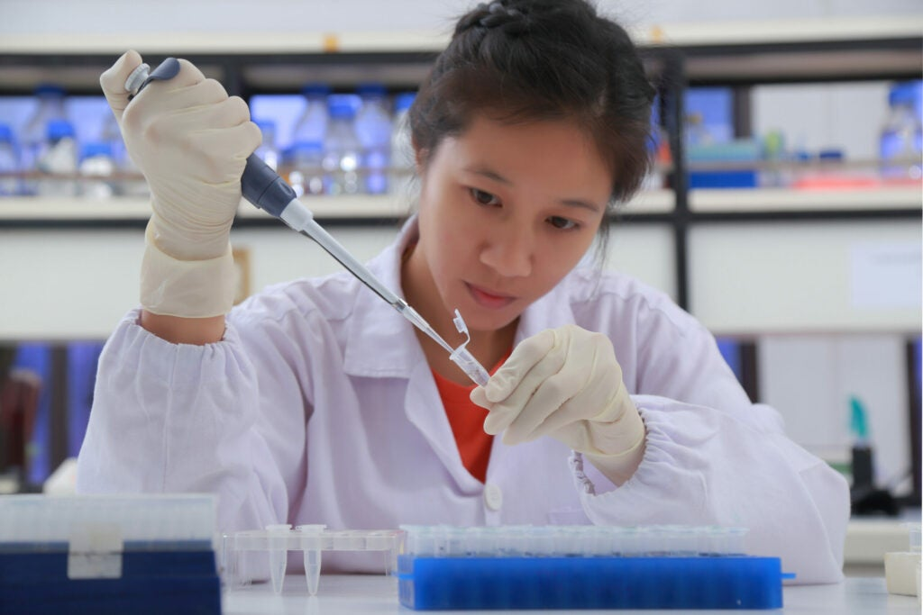 scientist pipeting in the lab