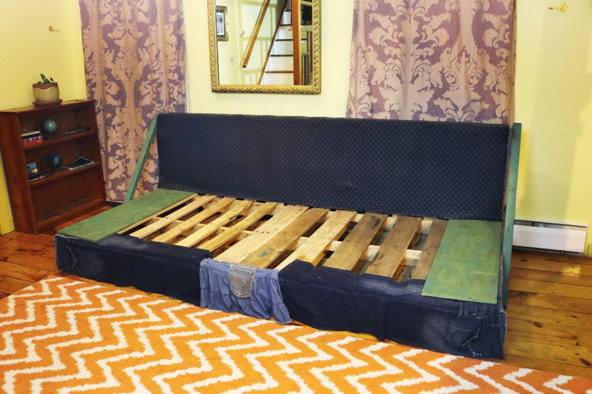 a couch made out of wooden pallets