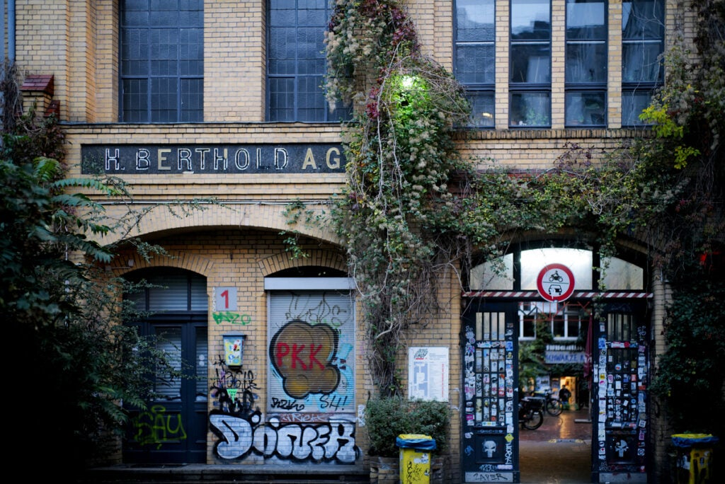 gated breezeway with graffiti