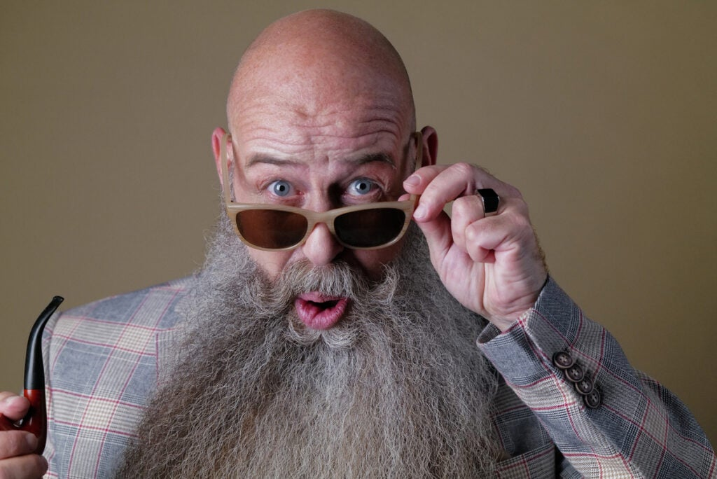 bald man with sunglasses and grey beard