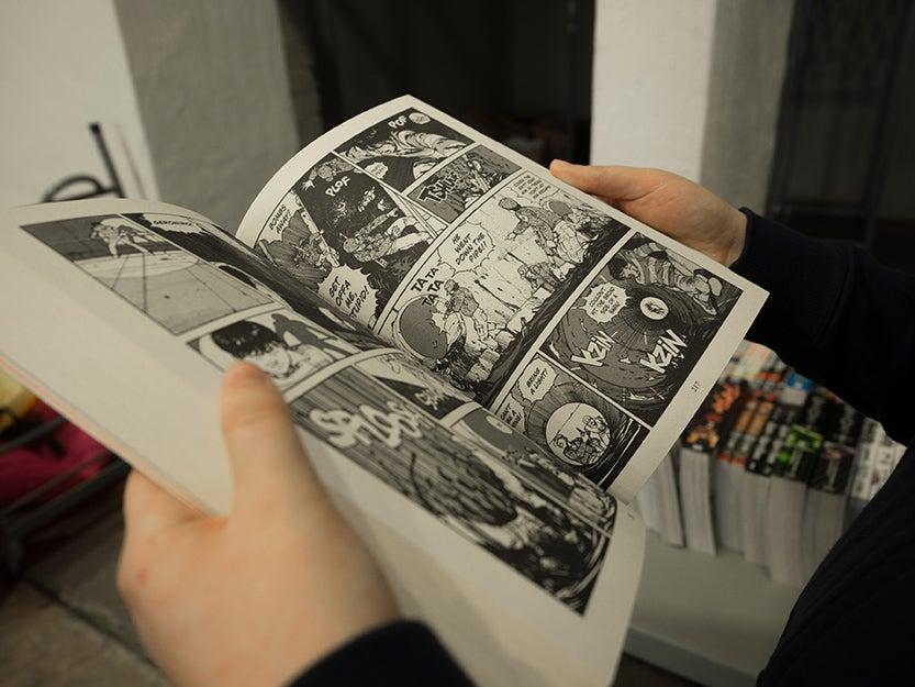 graphic novel in hands