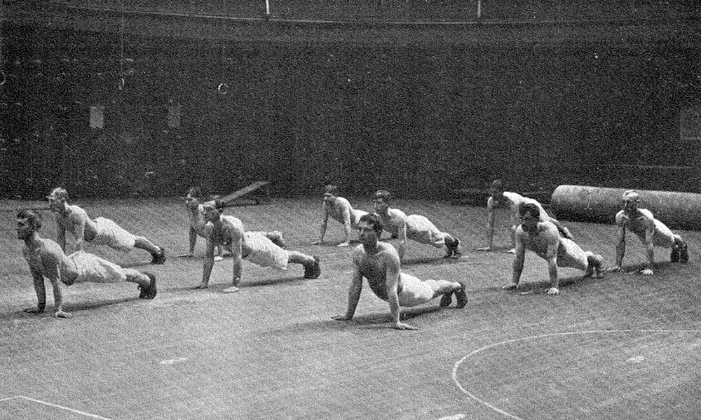 Soldiers exercising in a gymnasium