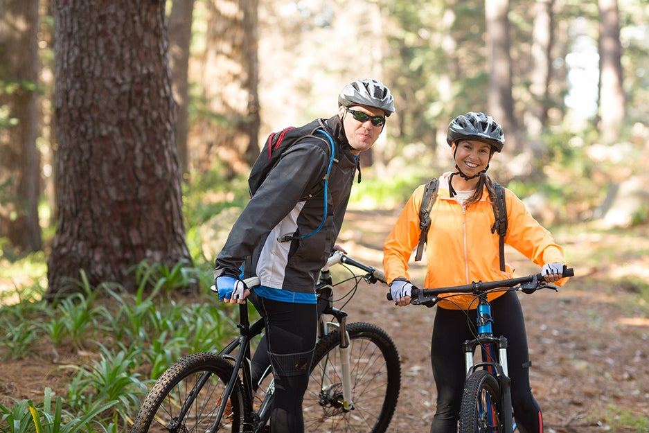 two people on a bike trail with bikes