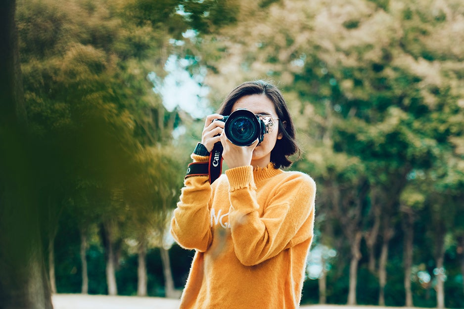 woman taking a photo with a camera