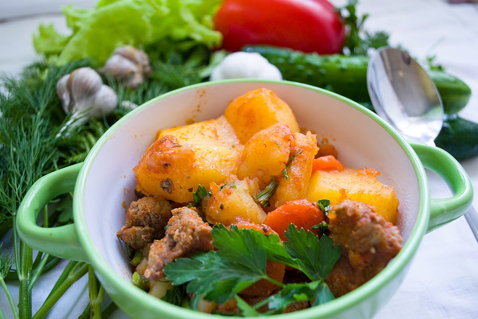 food in a bowl surrounded by fresh ingredients