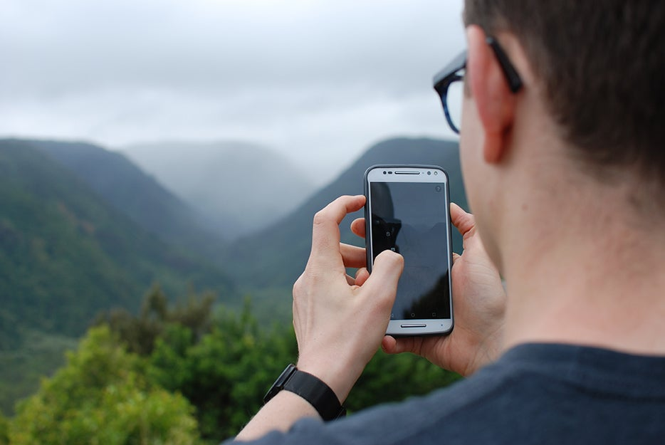 man on phone on a mountain