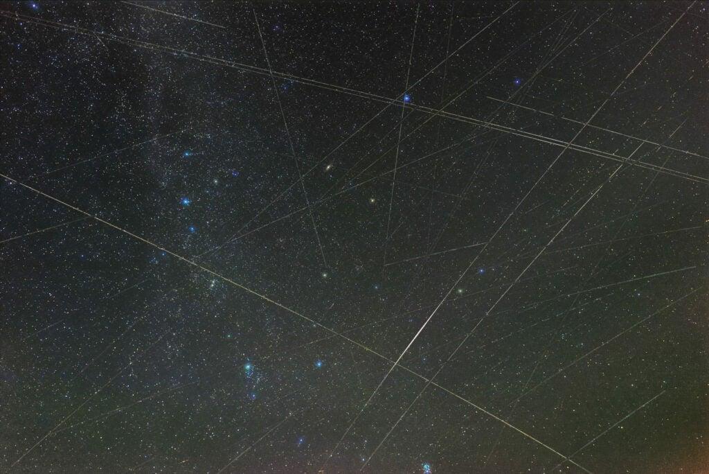 satellite streaks of light in a German sky