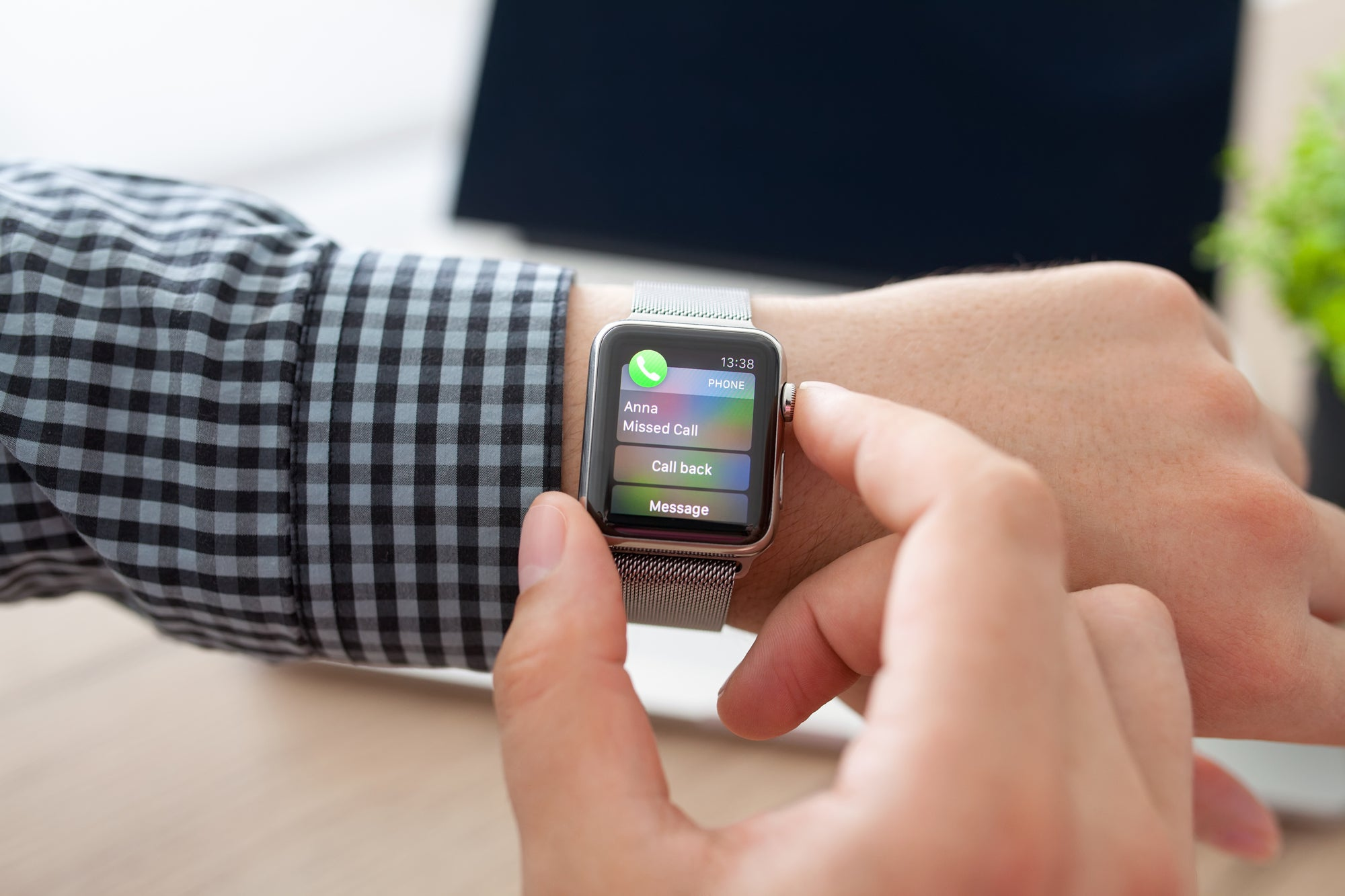 person wearing iwatch with missed call