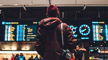 man standing in a train station