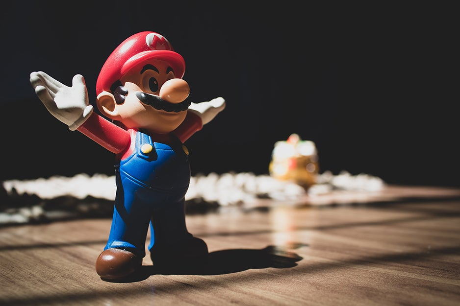 Mario figurine on a table.