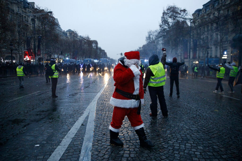 Protester dressed as santa claus in the Paris Riots