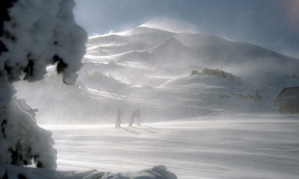 People skiing in a snowstorm