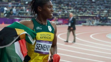 Caster Semenya on track with south african flag around her