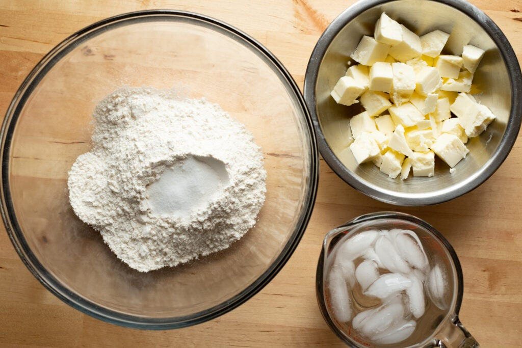 Bowls with flour sugar and butter